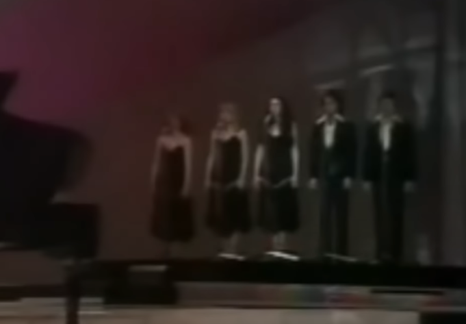 Three female and two male backing singers