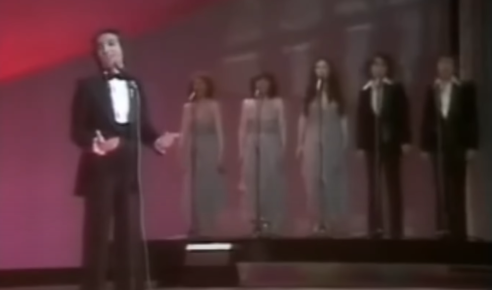 Joël Prévost with three female and two male backing singers